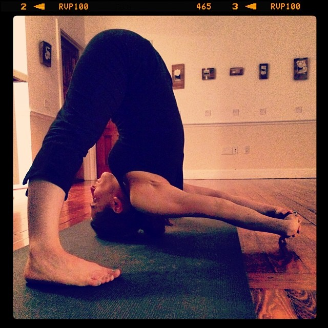 Prasarita Padottasana C is a balance of strength and softness. Getting your hands to the ground isn't easy because you have to let go of all of the stress and anger behind your heart. If you just take deep breaths, and lower with each exhale - one day you'll get there!